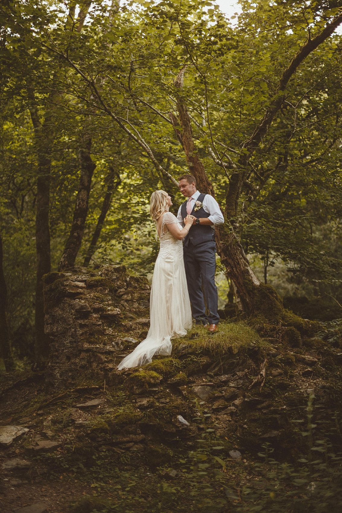 bride and groom in the forest looking at one another portrait
