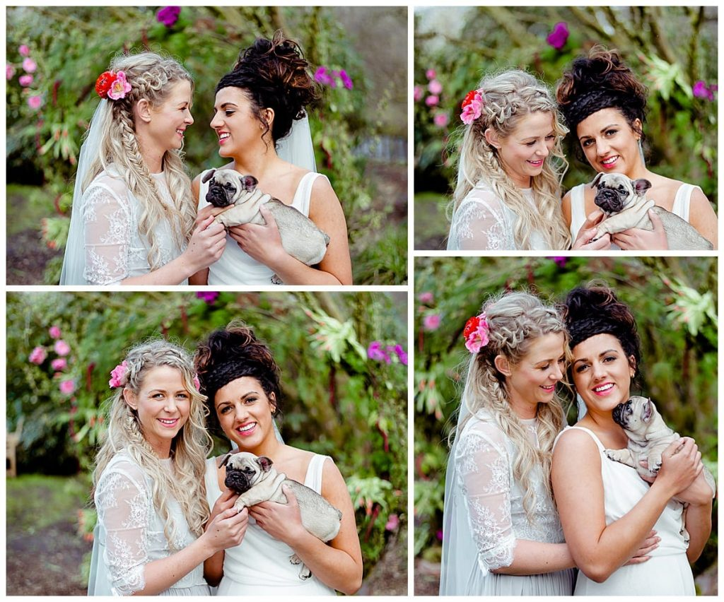 2 brides elopement holding Frenchie puppy
