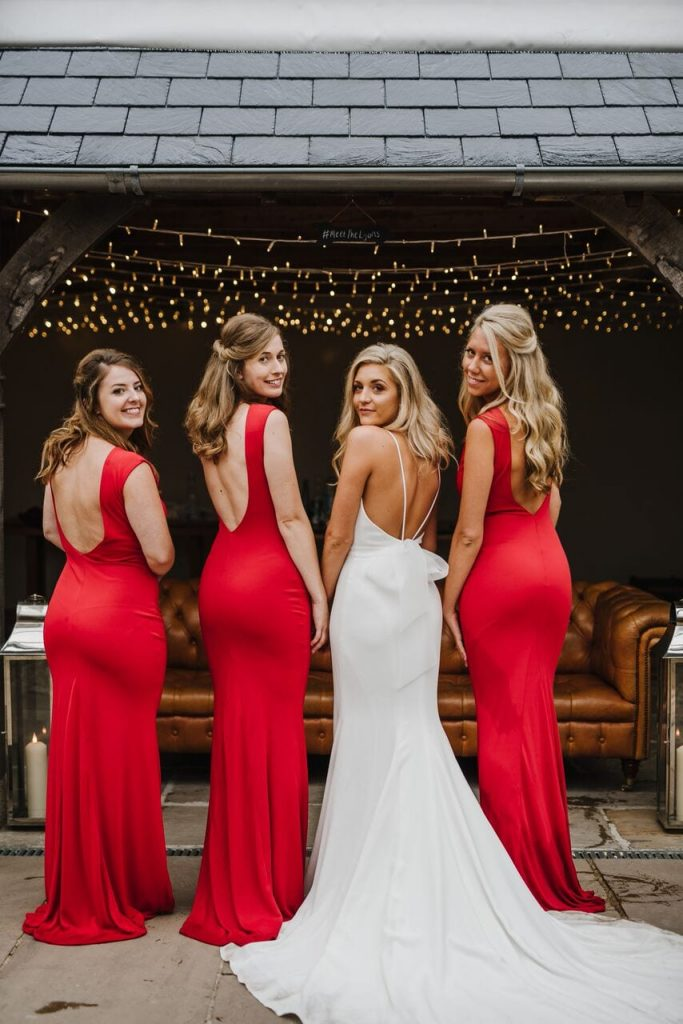 bridesmaids ever after blog post bride and bridesmaids in bright red
