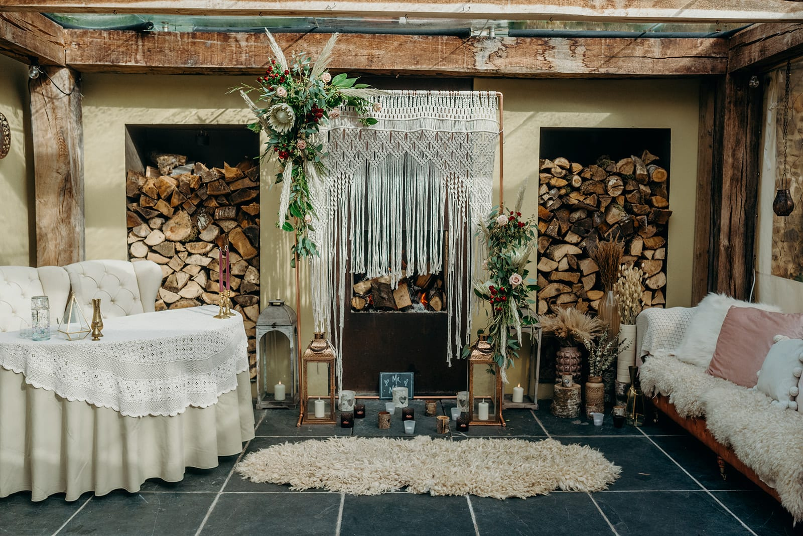 elopement ceremony back drop macrame frame white protea sheepskins