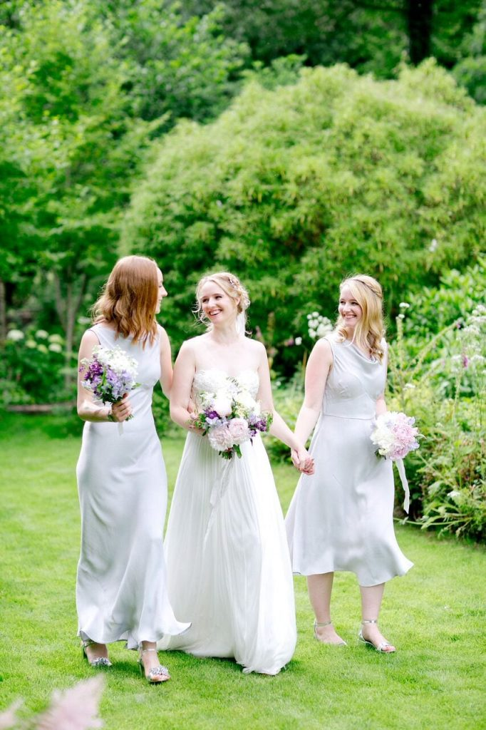bridesmaids ever after blog post bride and bridesmaids in garden