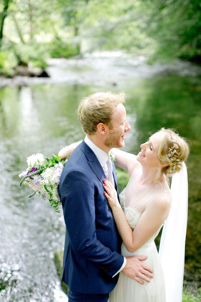 bride groom close up laughing dartmoor river backdrop
