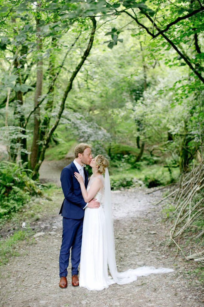 bride groom side shot kissing woodland