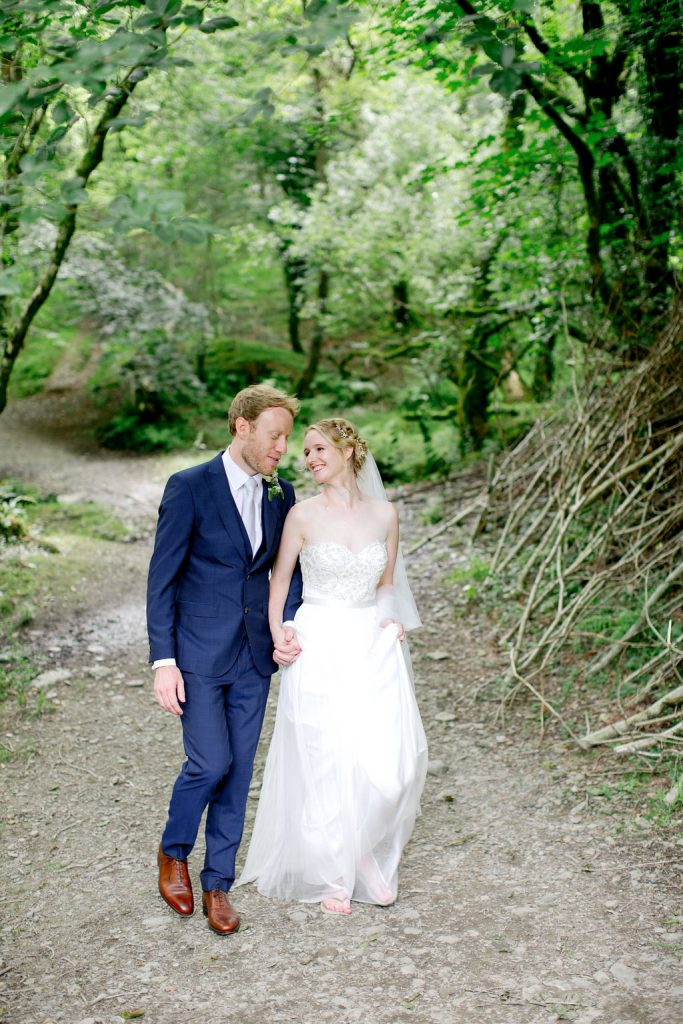 bride groom strolling woodland