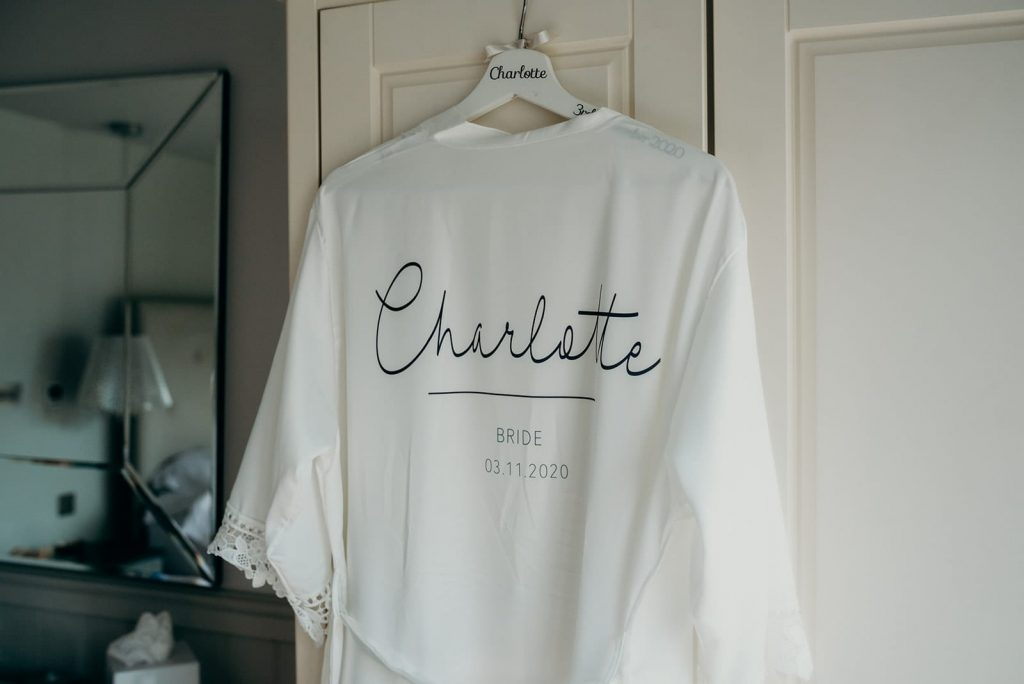 white robe with bridal name and date