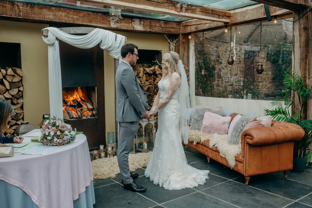bride and groom elopement wedding ceremony facing each other