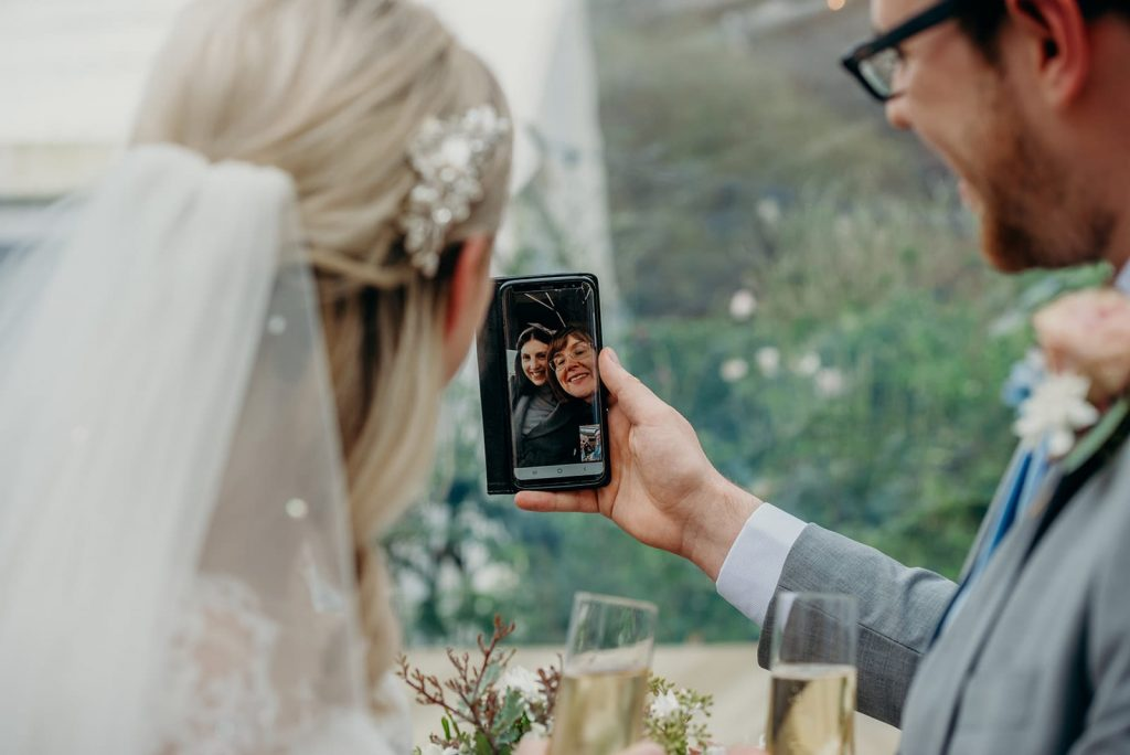 bride and groom FaceTiming family