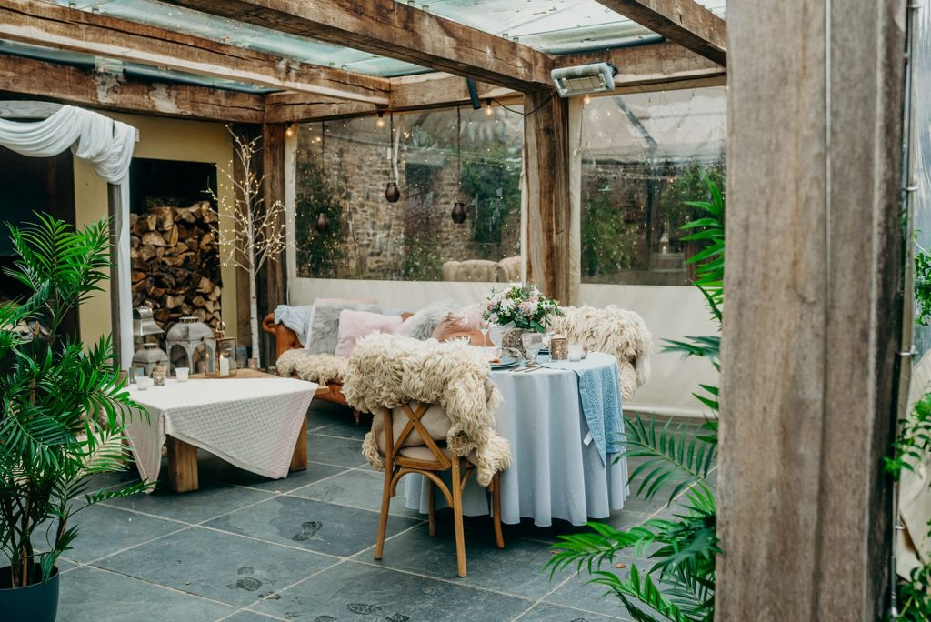 sweetheart table glass roof terrace slate floor