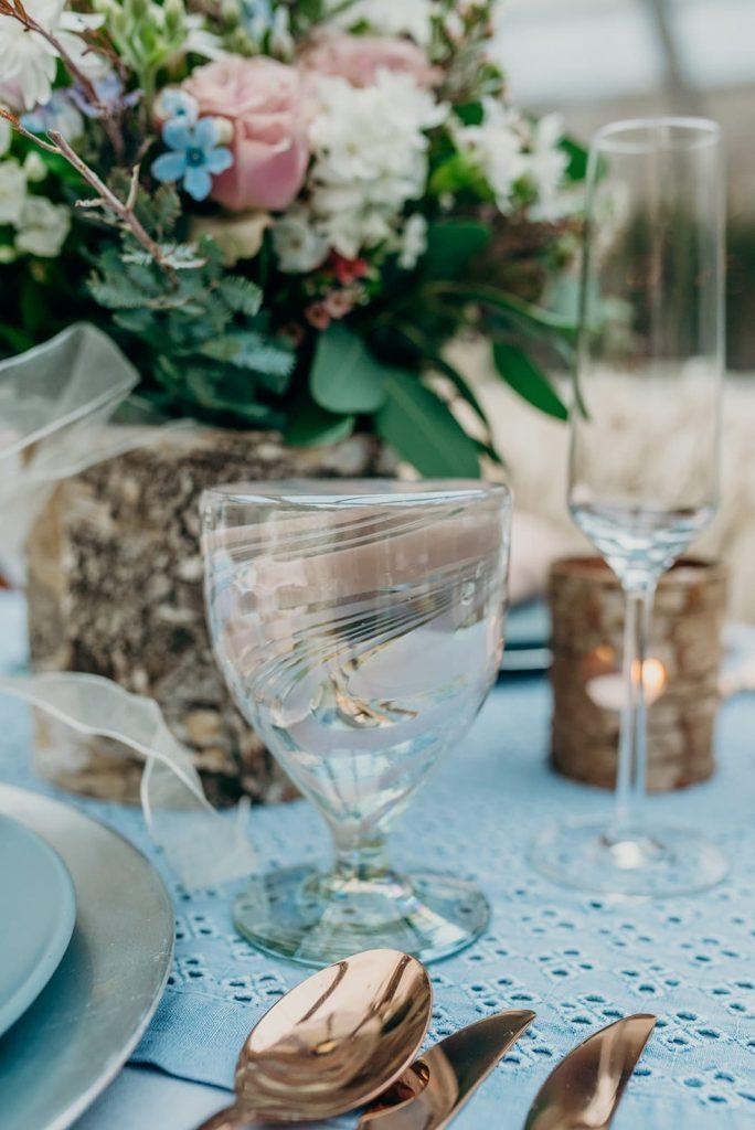 closeup sweetheart wedding table candles glasses