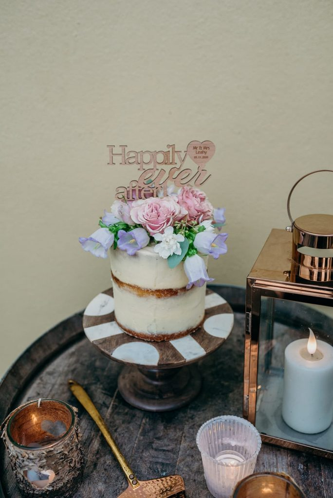 elopement wedding cake with topper and fresh flowers