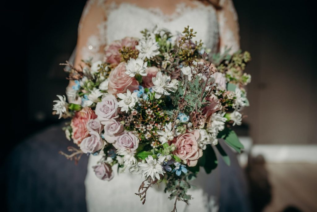 close up of blush pink white and blue bridal bouquet