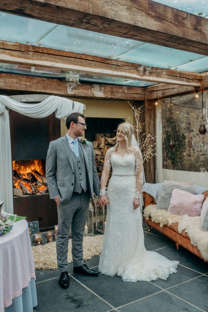 bride and groom fireside elopement ceremony