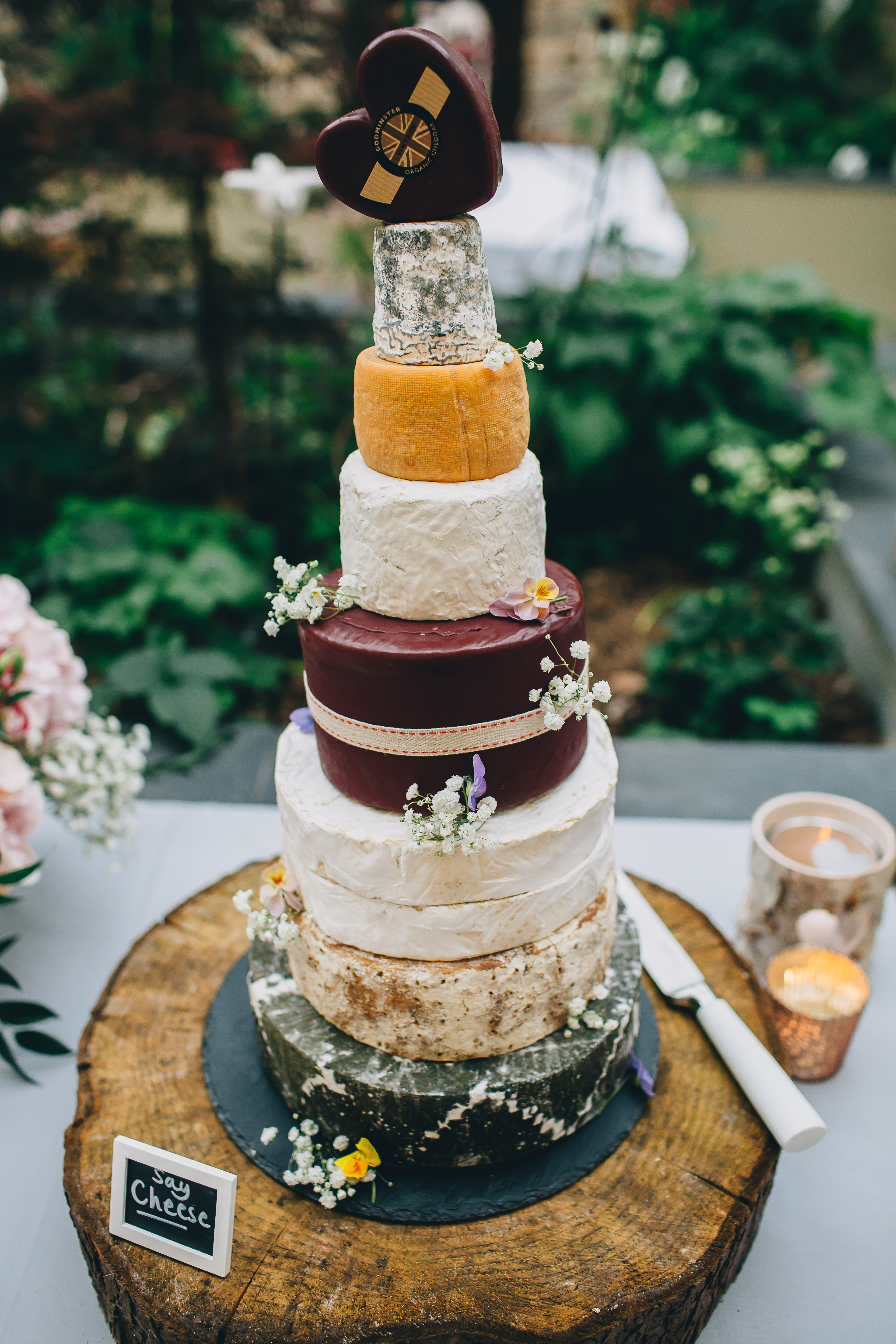 cheese, wheel, stinky, wedding, tower, cake, heart, ever after, cheese gromit, flower, fruit, leaves, ribbon, wax, colours, crackers