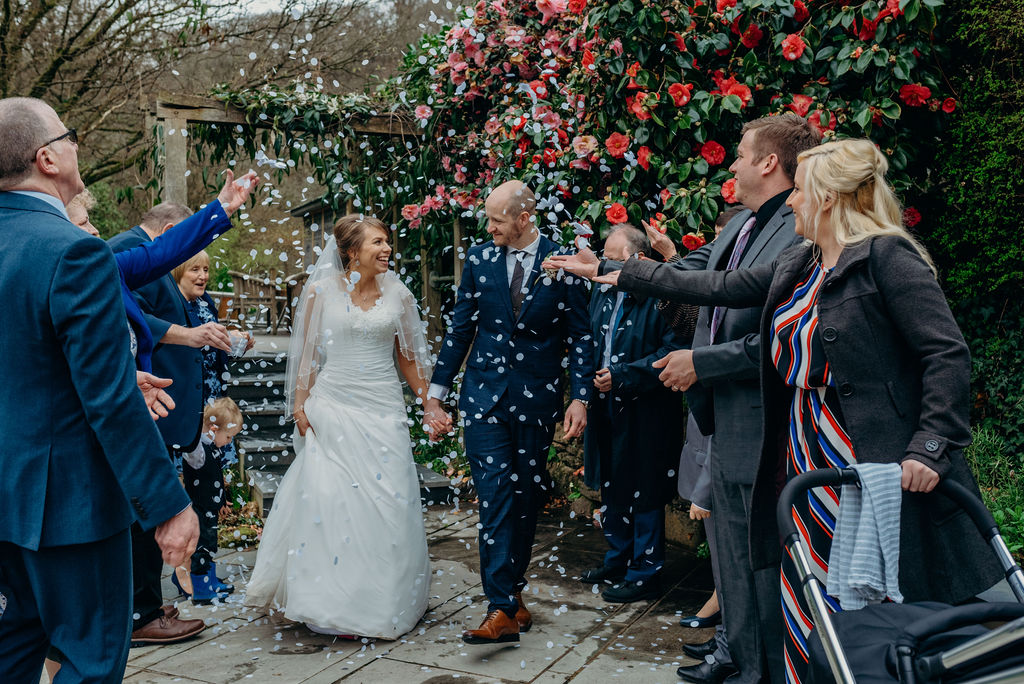 bride & groom, guests, happy, smiles, confetti, throw, white, bright, ever after