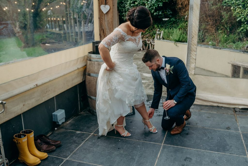 bride & groom changing shoes