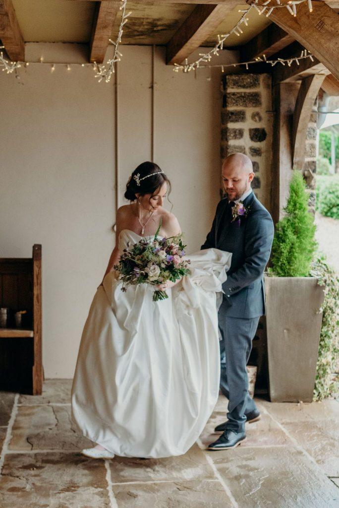 bride & groom walking into ceremony