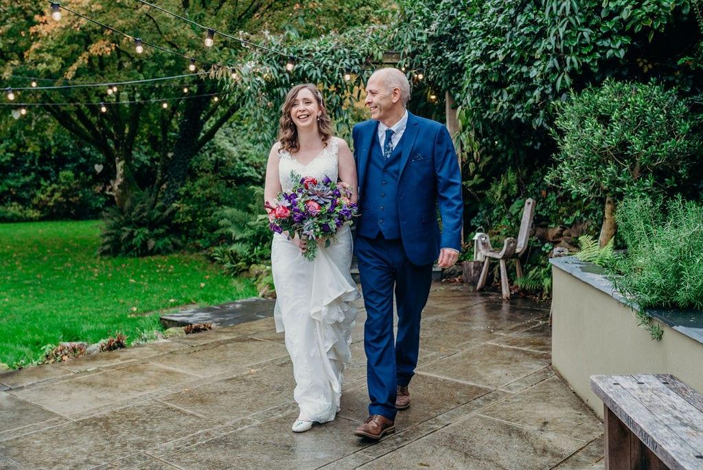 walking bride down the aisle