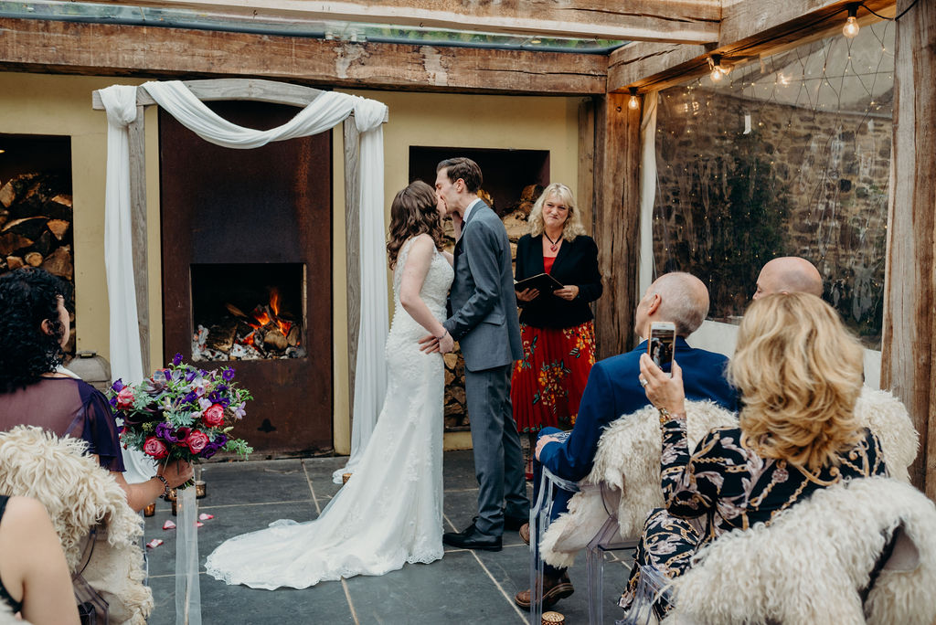 bride & groom ceremony kiss