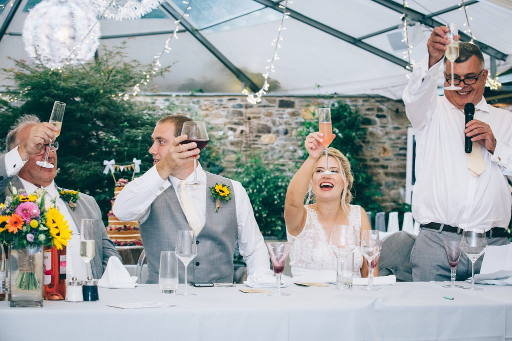 bride groom wedding speeches raising glasses