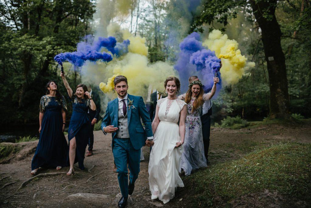 bride and groom smoke bomb celebration