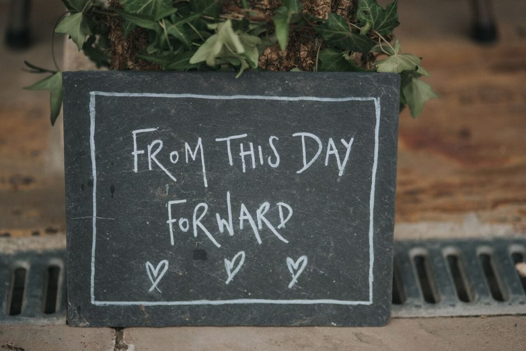 arrival and ceremony blog post ever after's slate signs