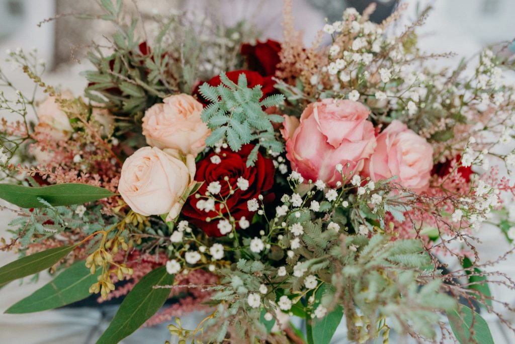 november recap elopement wedding bouquet pinks and reds