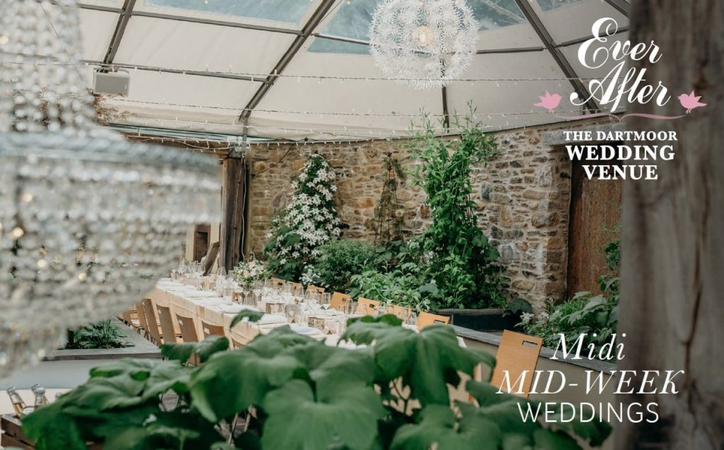 wedding breakfast set up terrace stone wall water feature