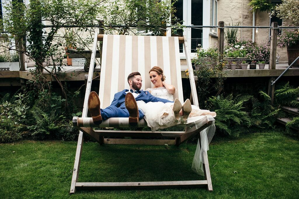 rachel & francis july 2017 bride and groom on deckchair