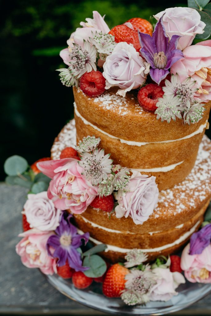 Rebecca-and-Louise-naked-cake-flowers-and-strawberries