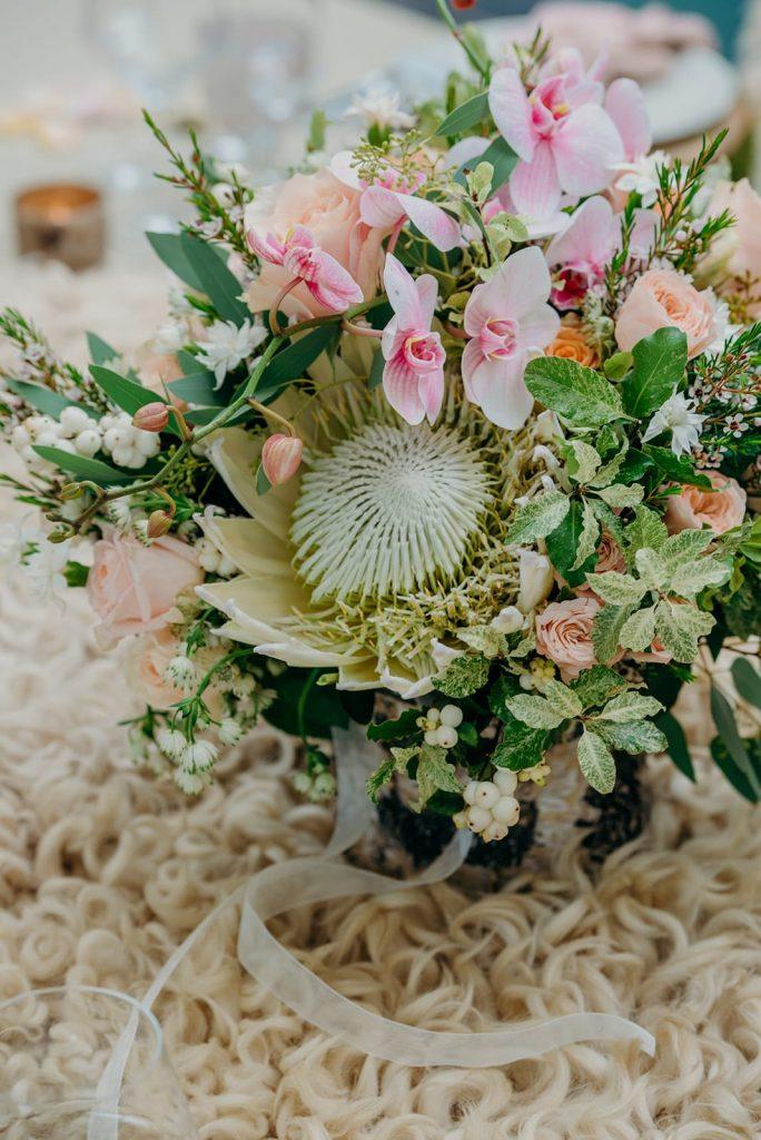 close up bridal bouquet white protea