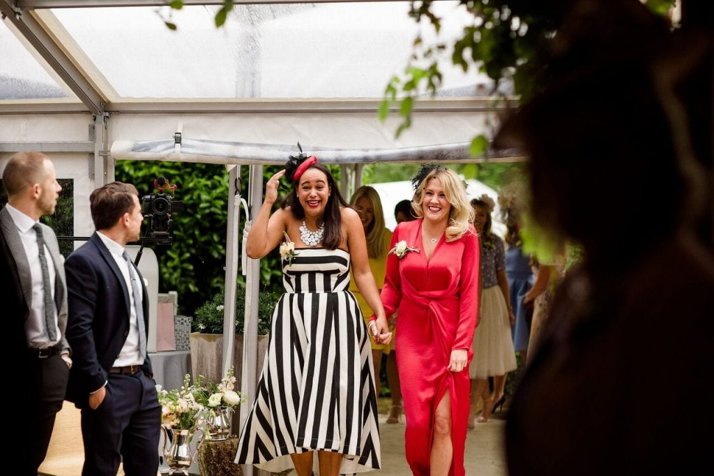 bridesmaids ever after blog post tribes maids walking down the aisle