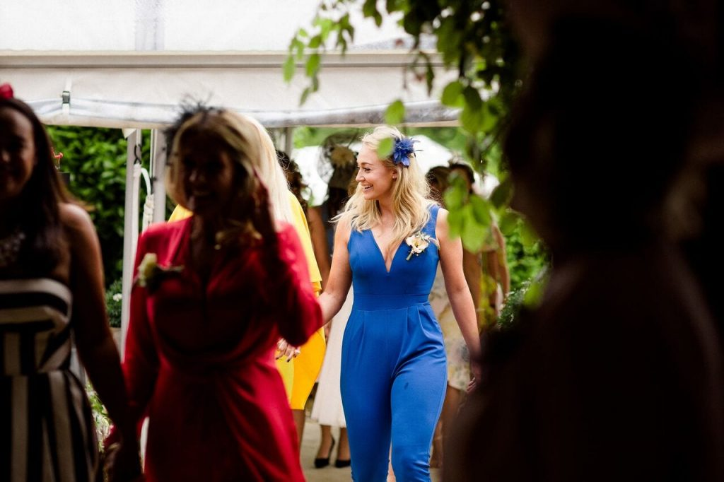 bridesmaids blog post ever after tribes maids walking down the aisle