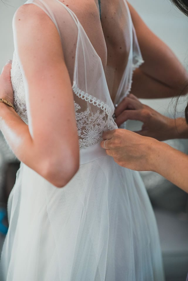 Wedding dress, back, buttons, putting on, doing up, helping hands, getting ready, ever after