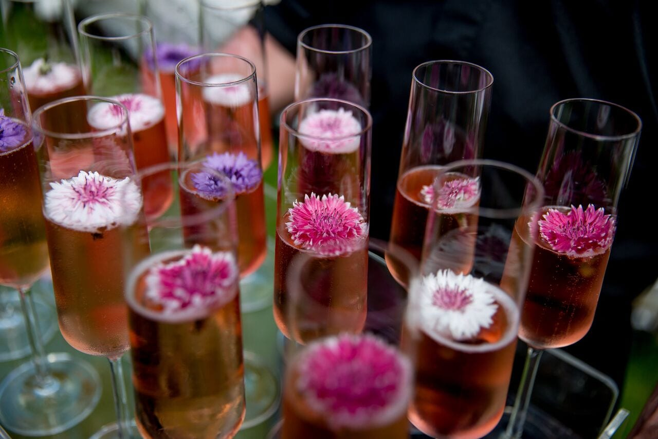 pink fizz, champagne flutes, edible flowers, pink, purple, white