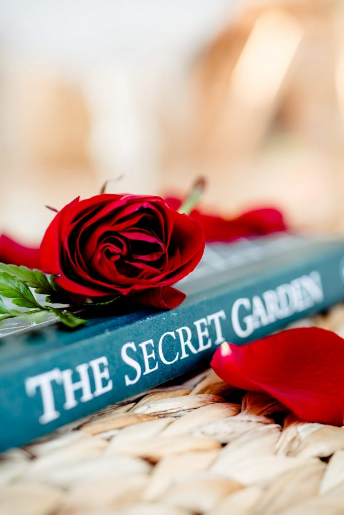 elopement photo shoot close up secret garden red rose